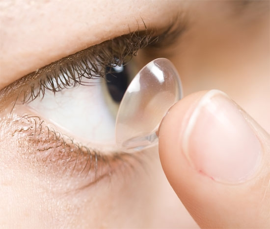 contact lens on a finger