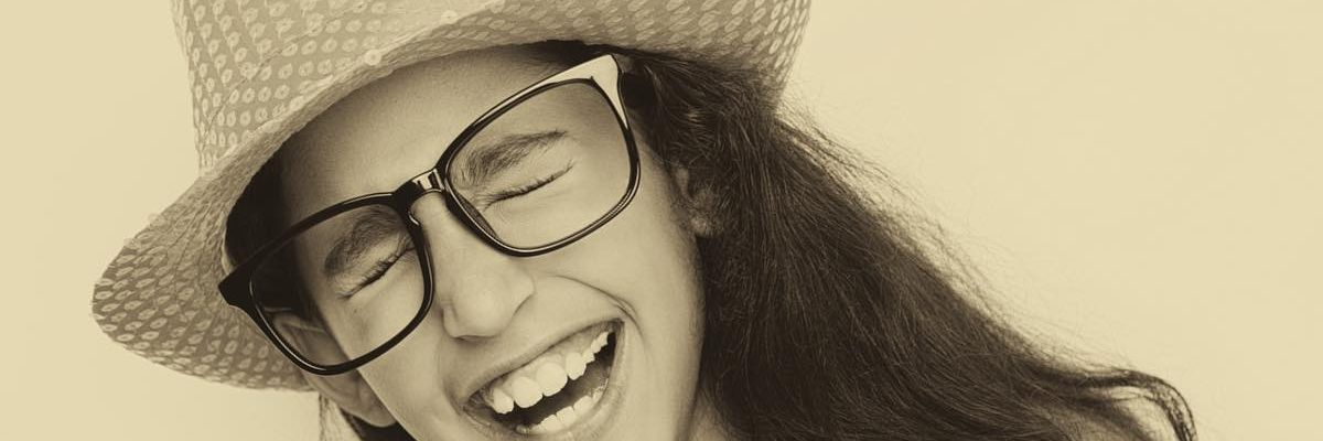 girl laughing in glasses